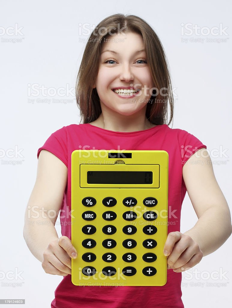 Young laughing   woman with  yellow  big calculator in her hands stock photo