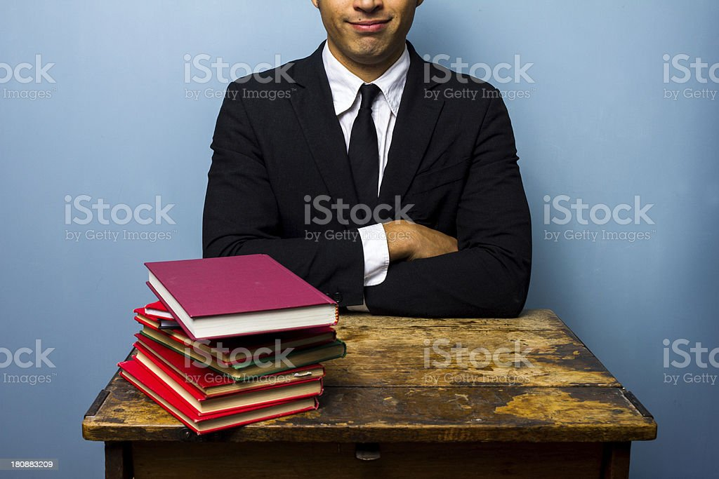 Young lawyer with stack of books royalty-free stock photo