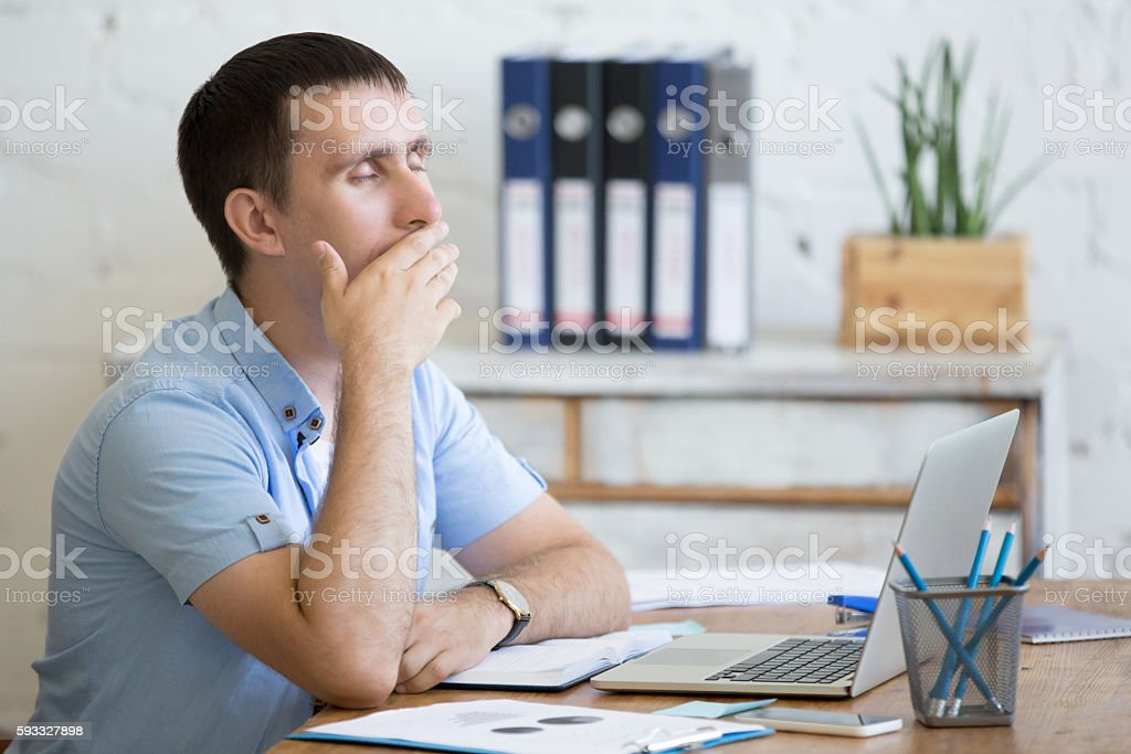 Young lazy worker man stock photo