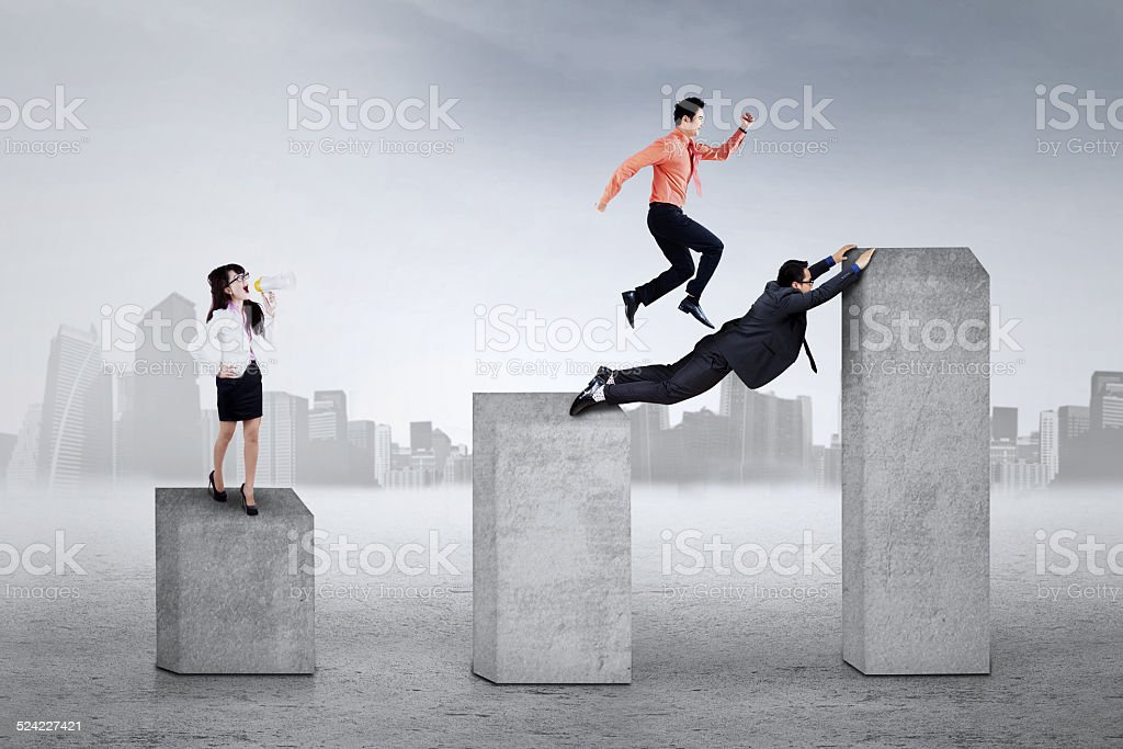 Young leader gives command to her workers stock photo