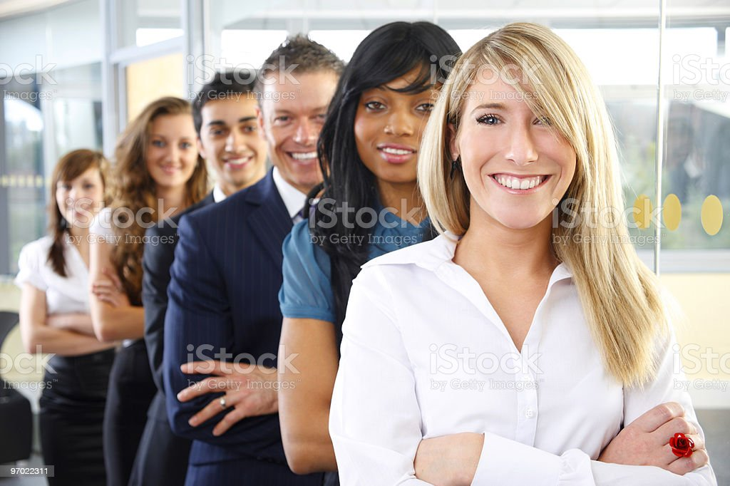 Young leader with her team in a row royalty-free stock photo