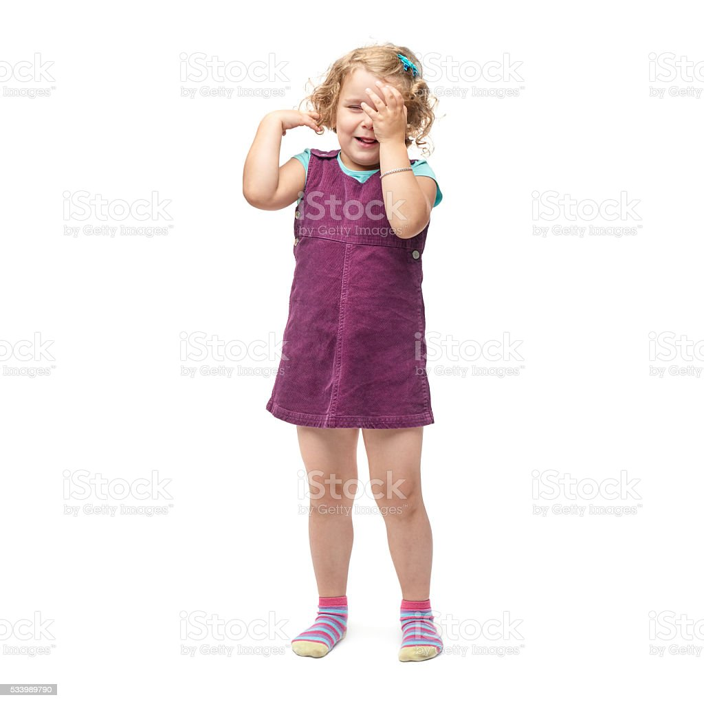 Young little girl standing over isolated white background stock photo