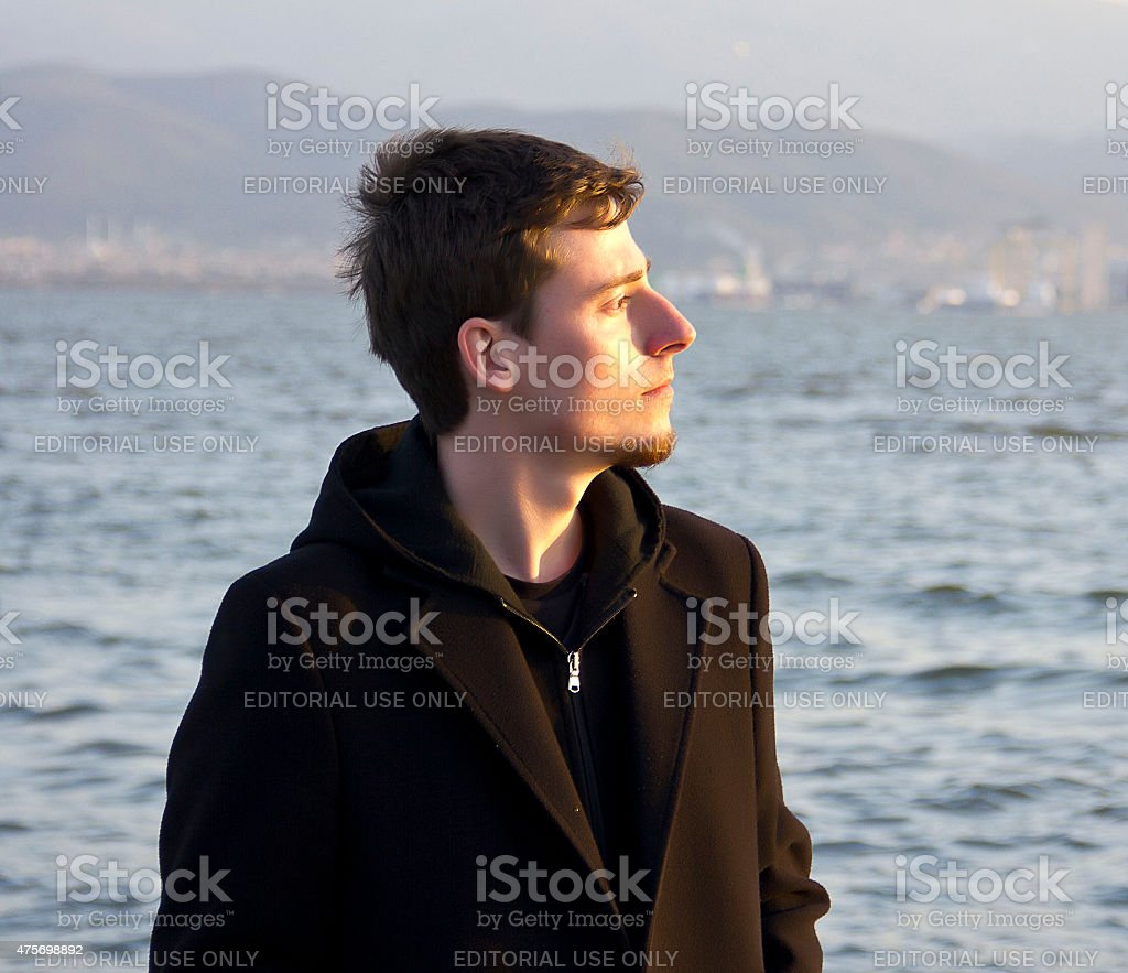 young lonely man stock photo