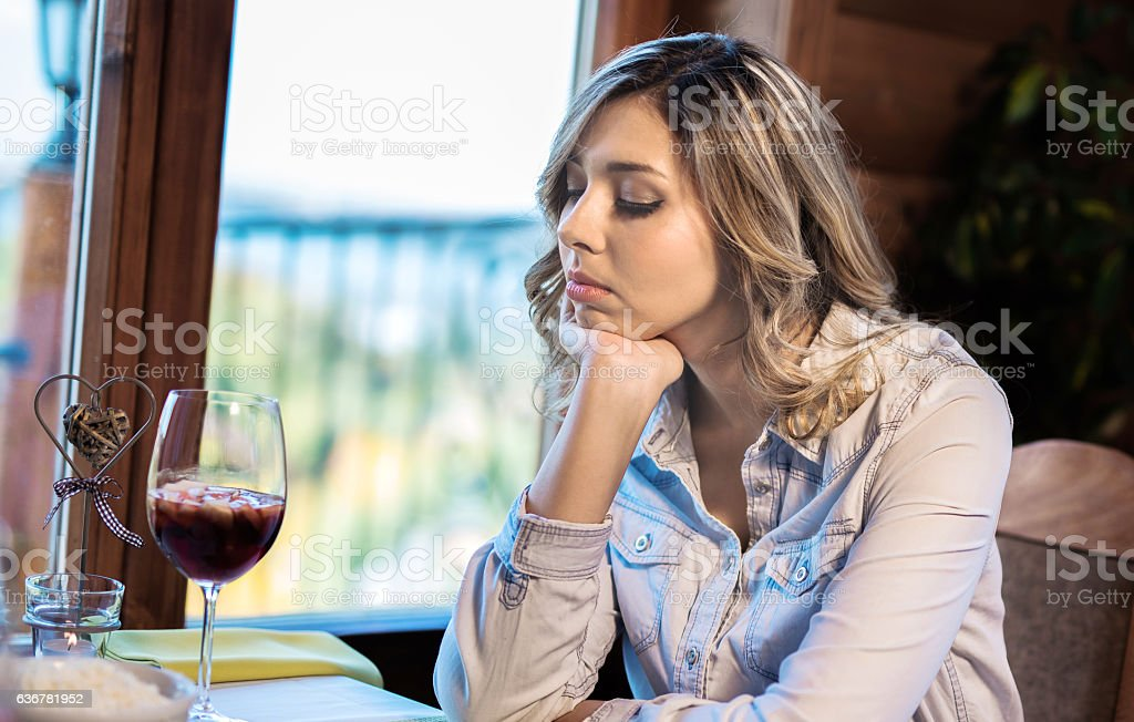 Young lonely woman having a headache from alcohol stock photo