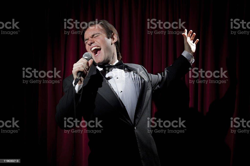 Young Lounge Singer Singing loud stock photo