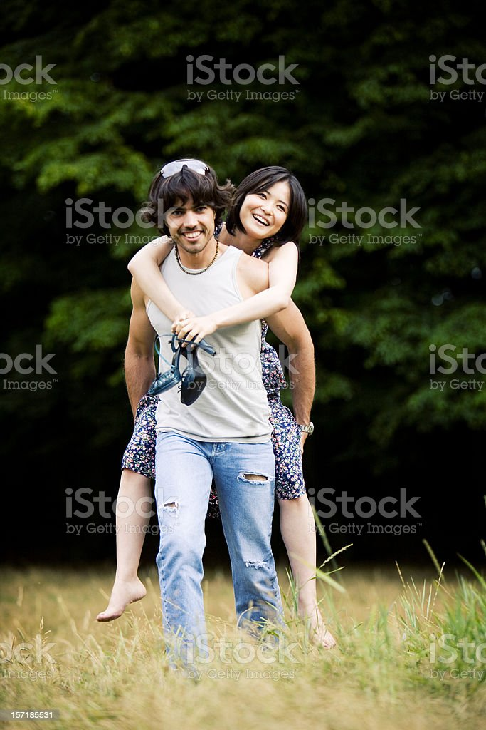 Young love between a playful attractive couple royalty-free stock photo