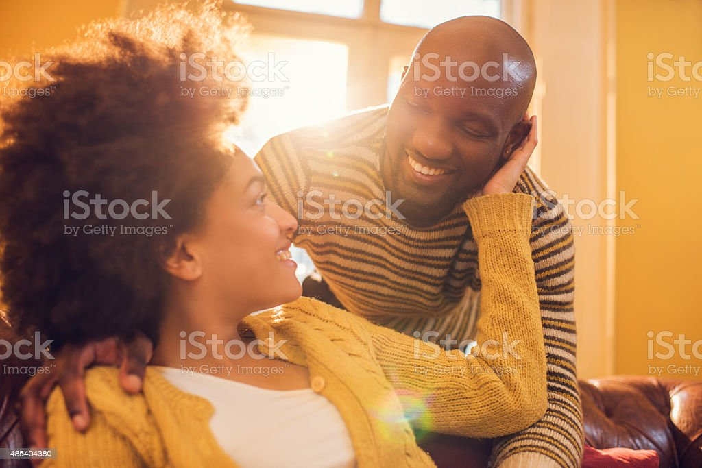 Young loving African American couple communicating at home. stock photo