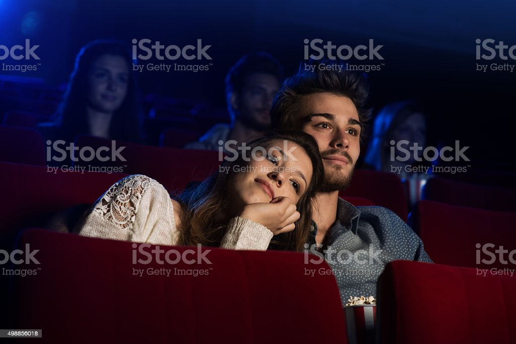 Young loving couple at the cinema stock photo