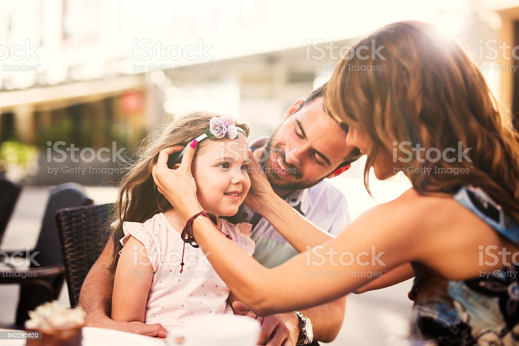 Young loving family having fun in a cafe. stock photo