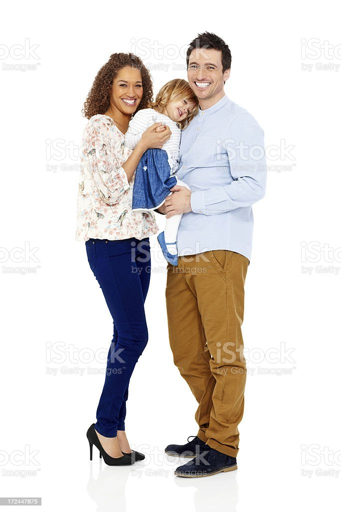 Young loving parents holding their baby girl royalty-free stock photo