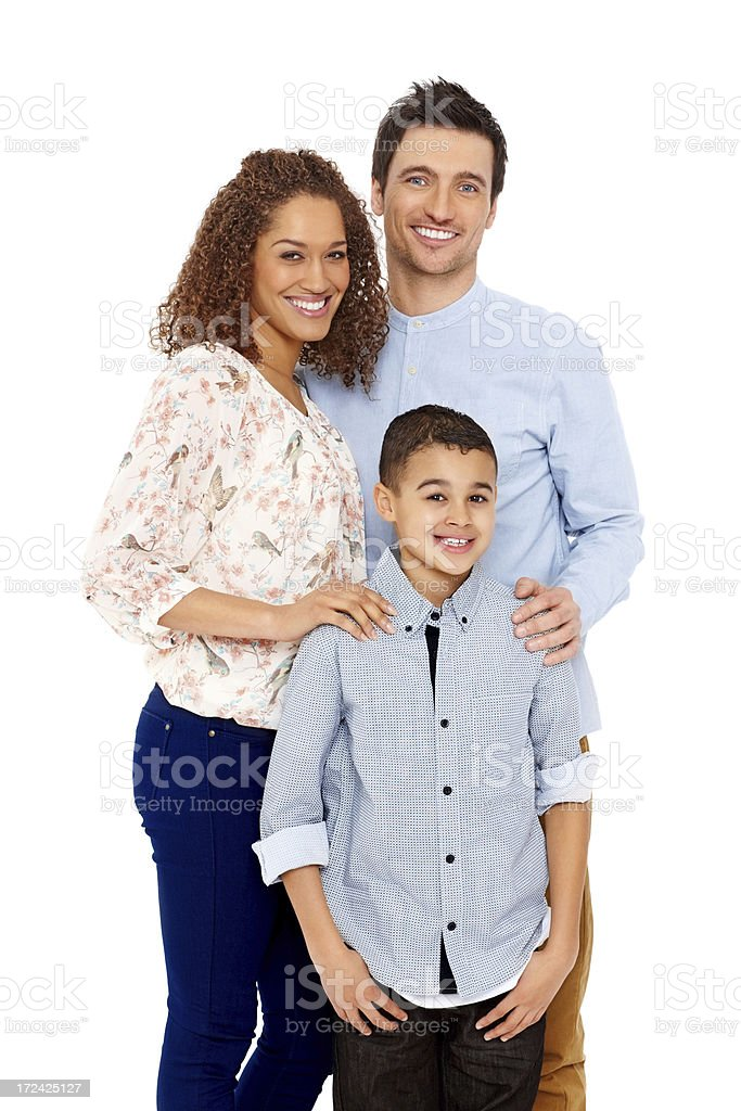 Young loving parents with their son standing on white royalty-free stock photo