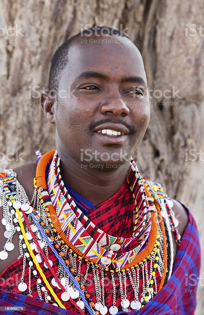 Young maasai man in traditional dress stock photo