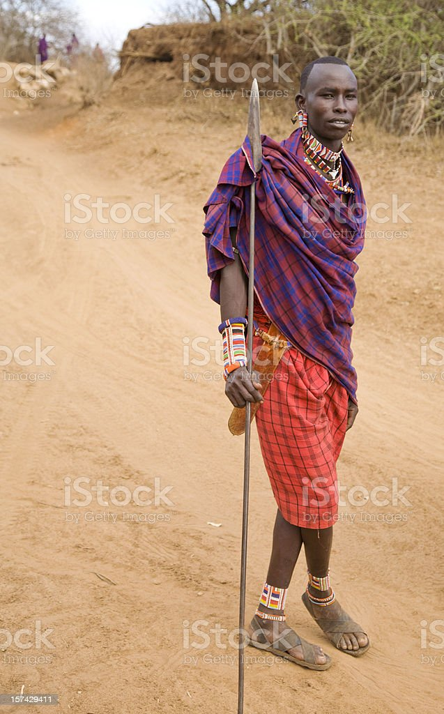 Young Maasai warrior with spear. stock photo