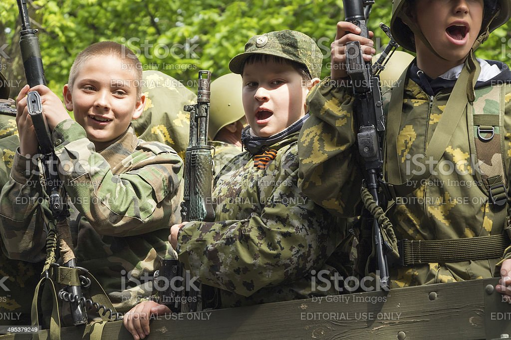Young machine gunners onboard the truck royalty-free stock photo