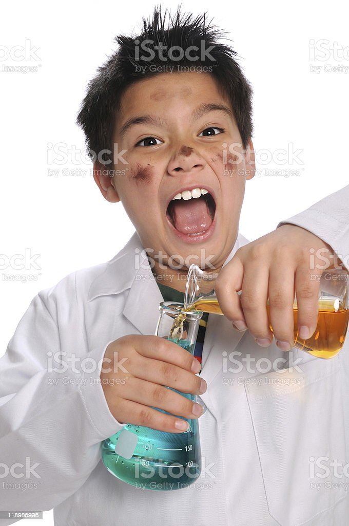 Young Mad Scientist Mixing Chemicals royalty-free stock photo