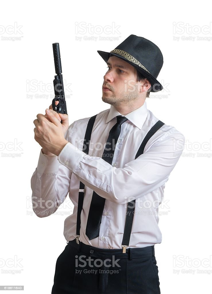 Young mafia man or racketeer holds gun with silencer. stock photo