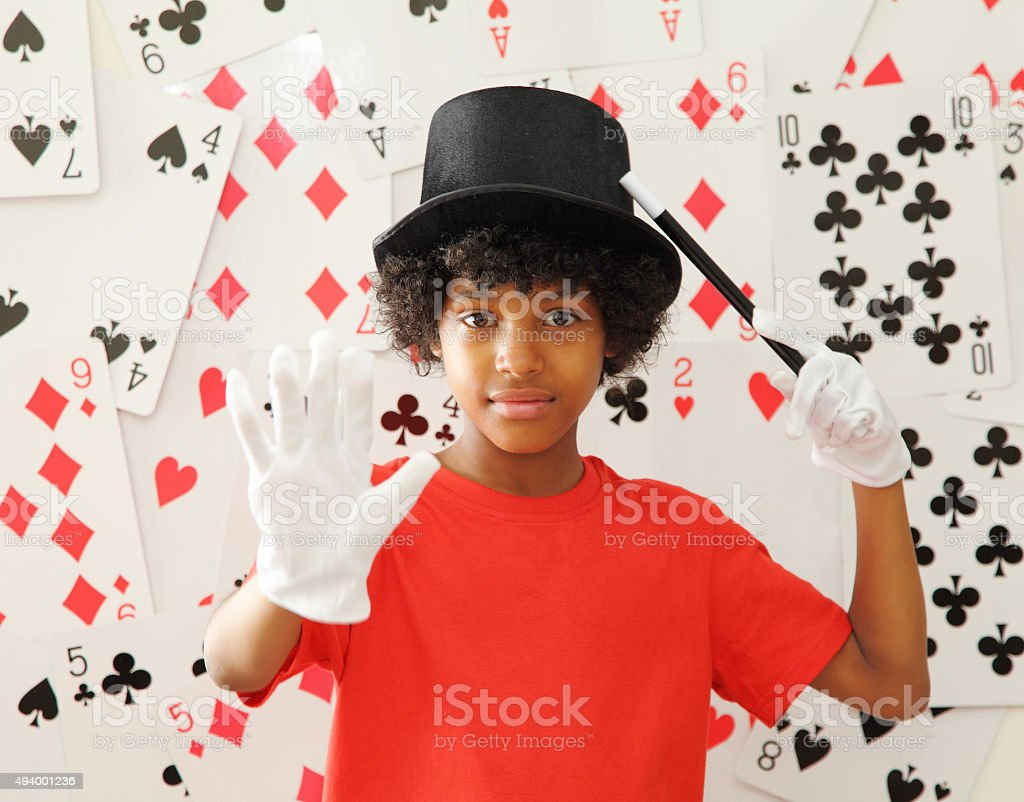 young magician with magic wand stock photo