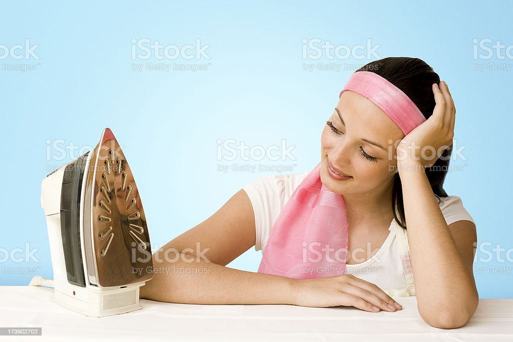 Young Maid ironing royalty-free stock photo