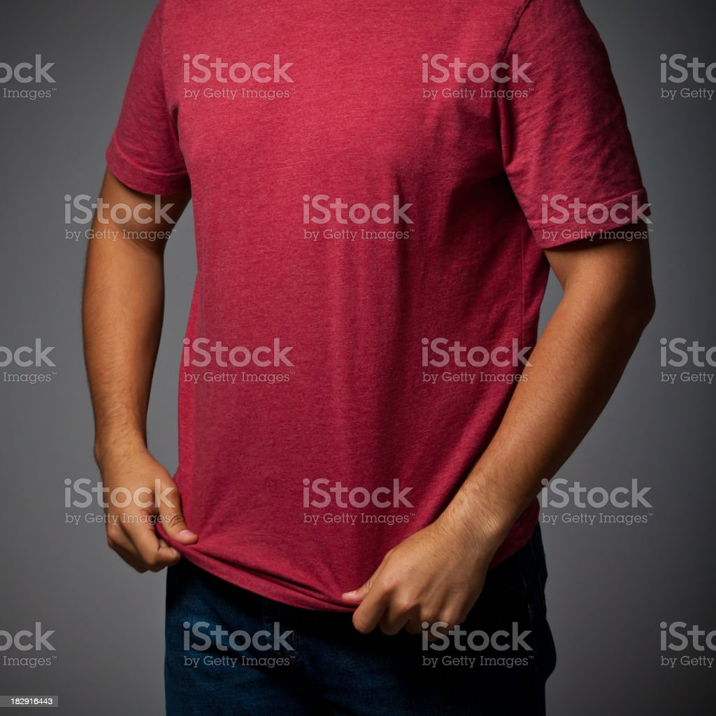 Young Male Adjusts Shirt royalty-free stock photo