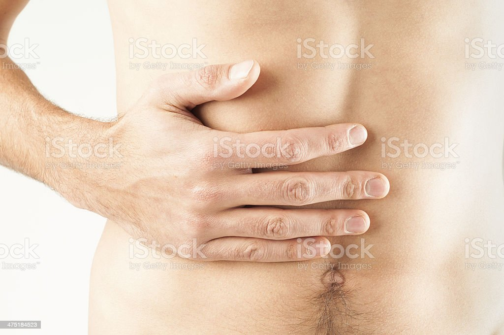 Young male adult with stomachache stock photo
