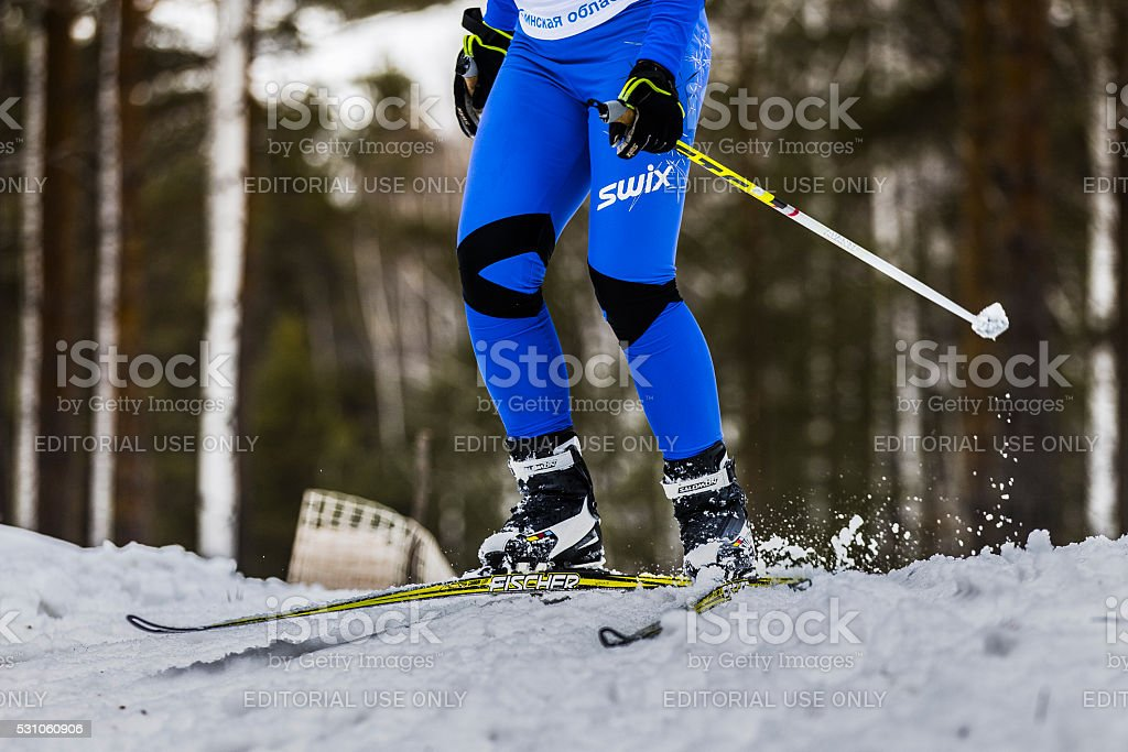 young male athlete skier coming down mountain on skis stock photo