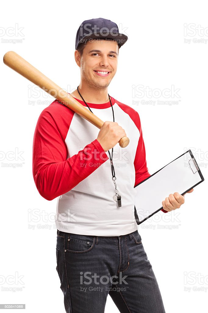 Young male baseball coach holding a clipboard stock photo
