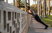 Young male black athlete exercising in the park, Los Angeles