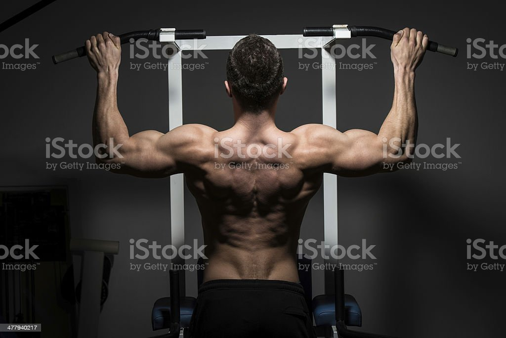 young male bodybuilder doing heavy weight exercise royalty-free stock photo