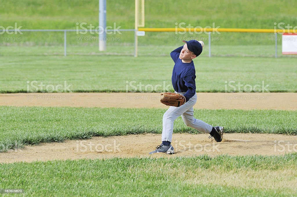 Young Male Boy Athlete Pitching on Baseball Field royalty-free stock photo