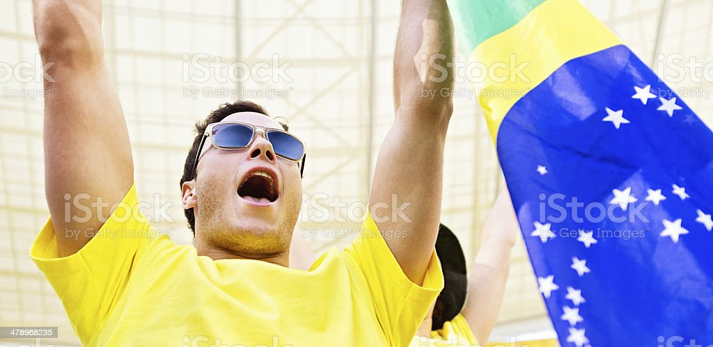 Young male Brazilian football fan waves the flag royalty-free stock photo