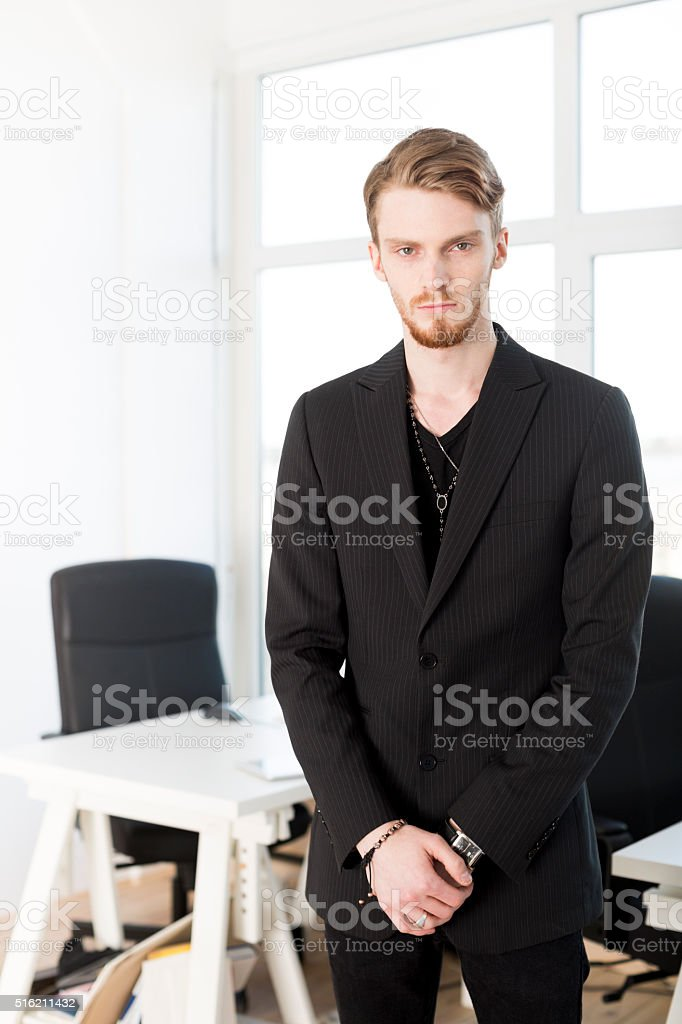 Young Male Business Owner's Portrait In A Small Bright Office stock photo