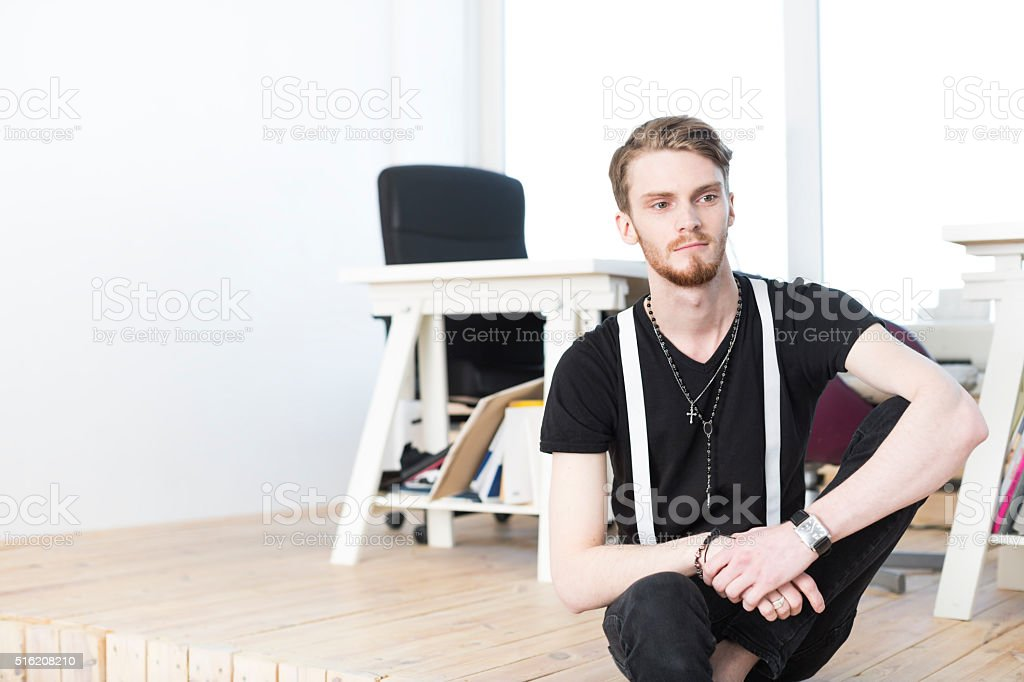 Young Male Businessman In A Modern White Minimalistic Office stock photo