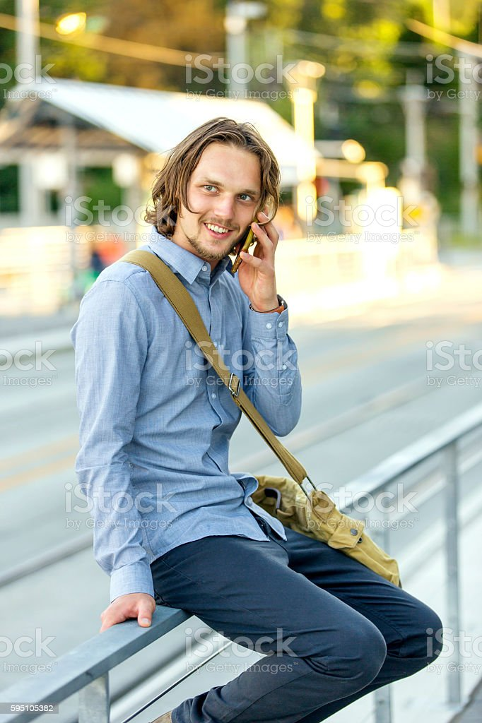 Young male businessman talking on the phone stock photo