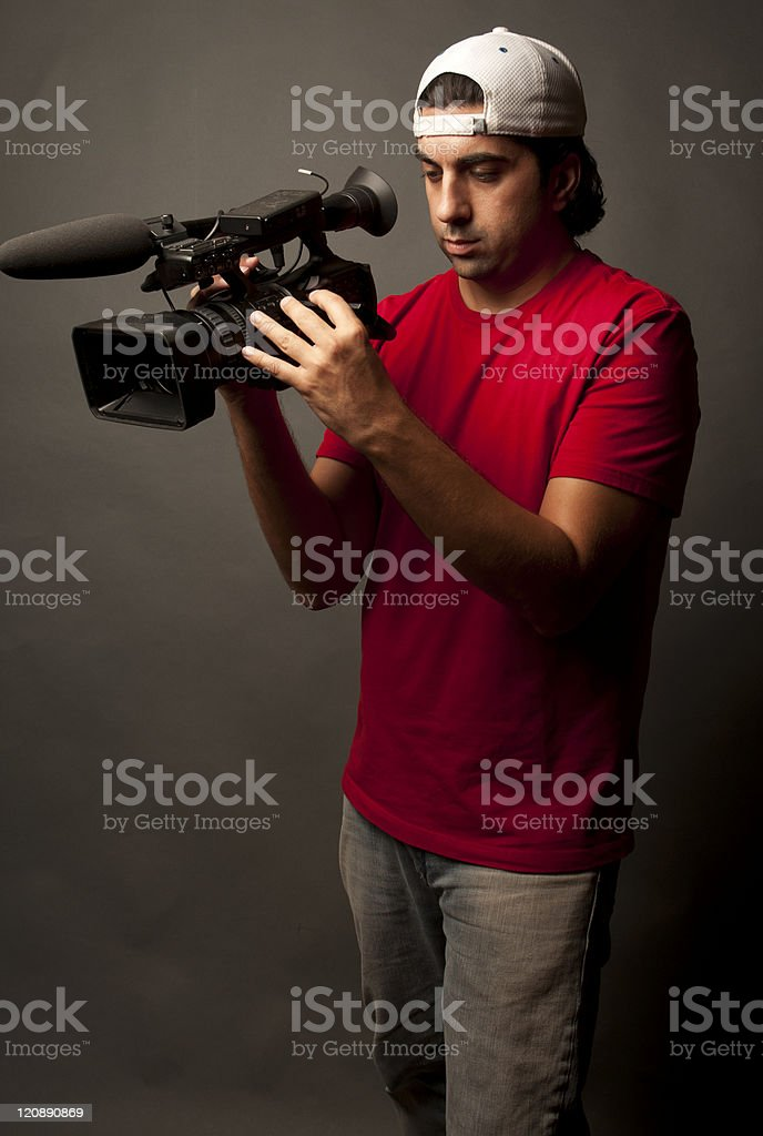 Young Male Camera Person Filming royalty-free stock photo