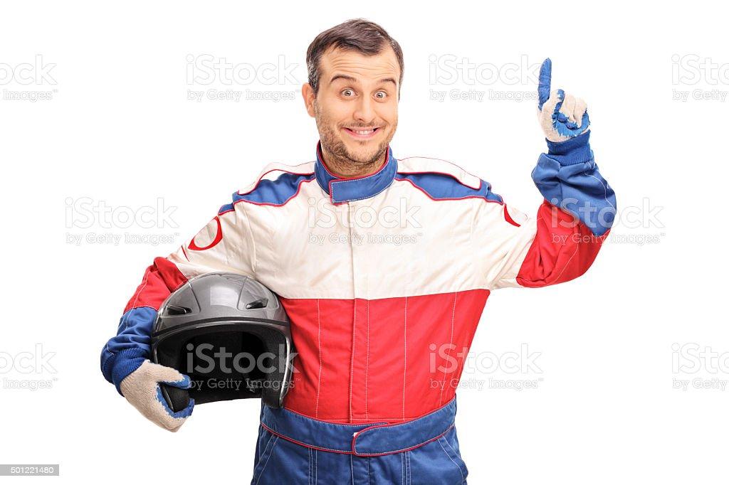 Young male car racer having an idea stock photo