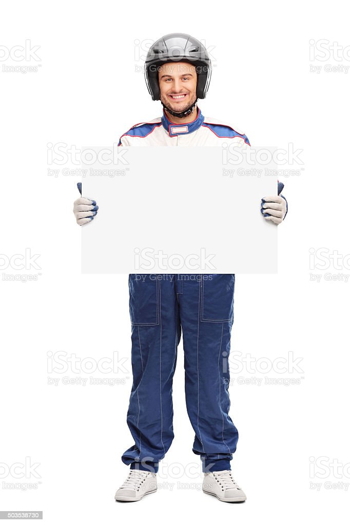 Young male car racer holding a blank banner stock photo