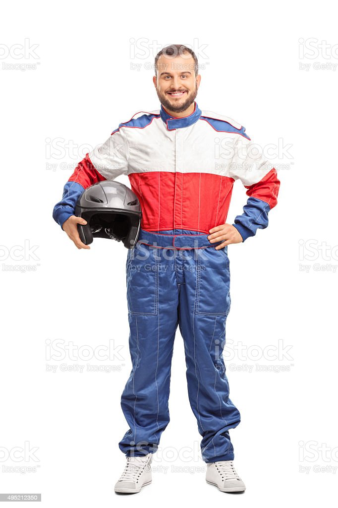 Young male car racer in overalls holding a helmet stock photo