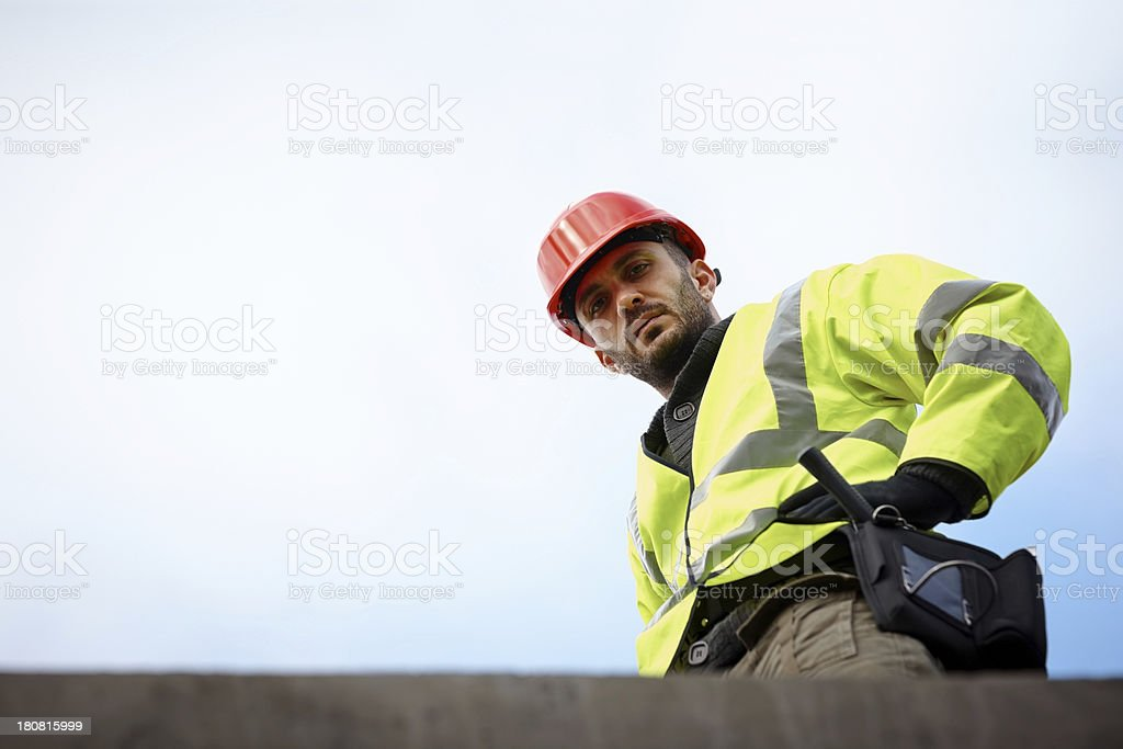 Young male construction worker standing at site stock photo