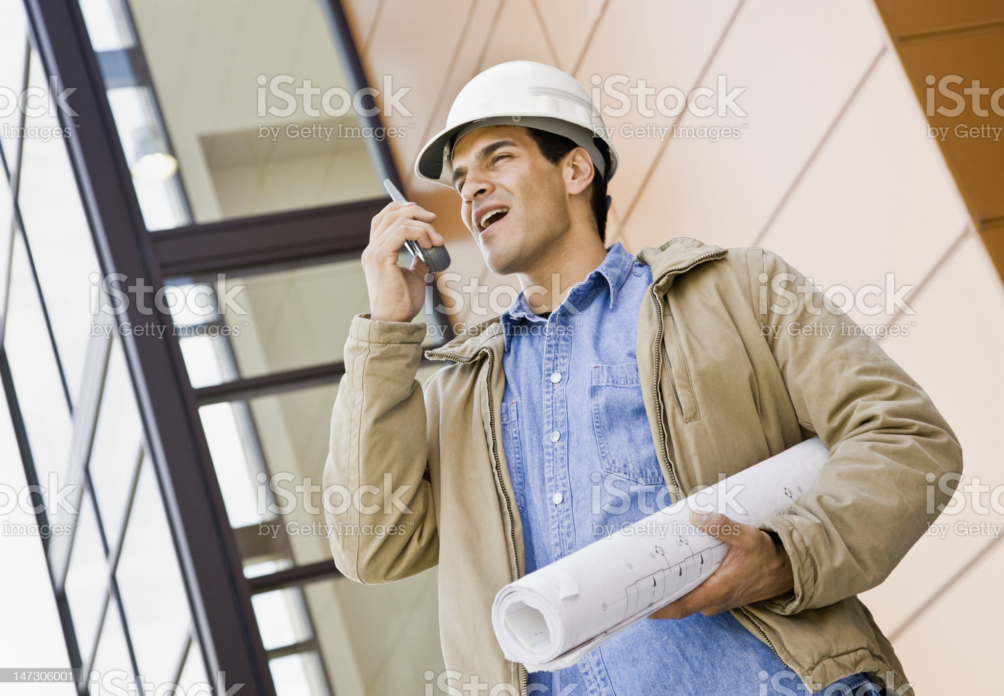 Young Male Construction Worker With Walkie-Talkie royalty-free stock photo