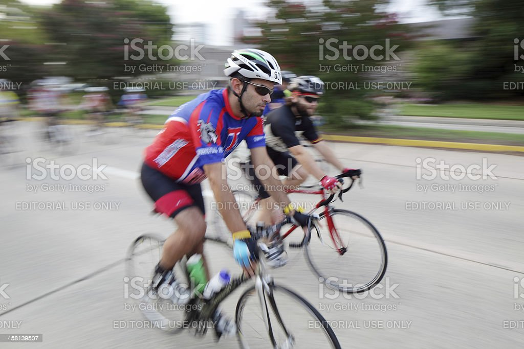 Young male cyclist riding a bicycle stock photo