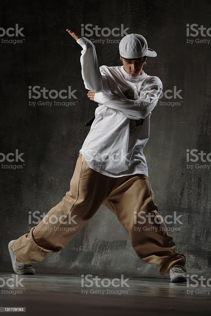 Young male dancer performing a dance stock photo