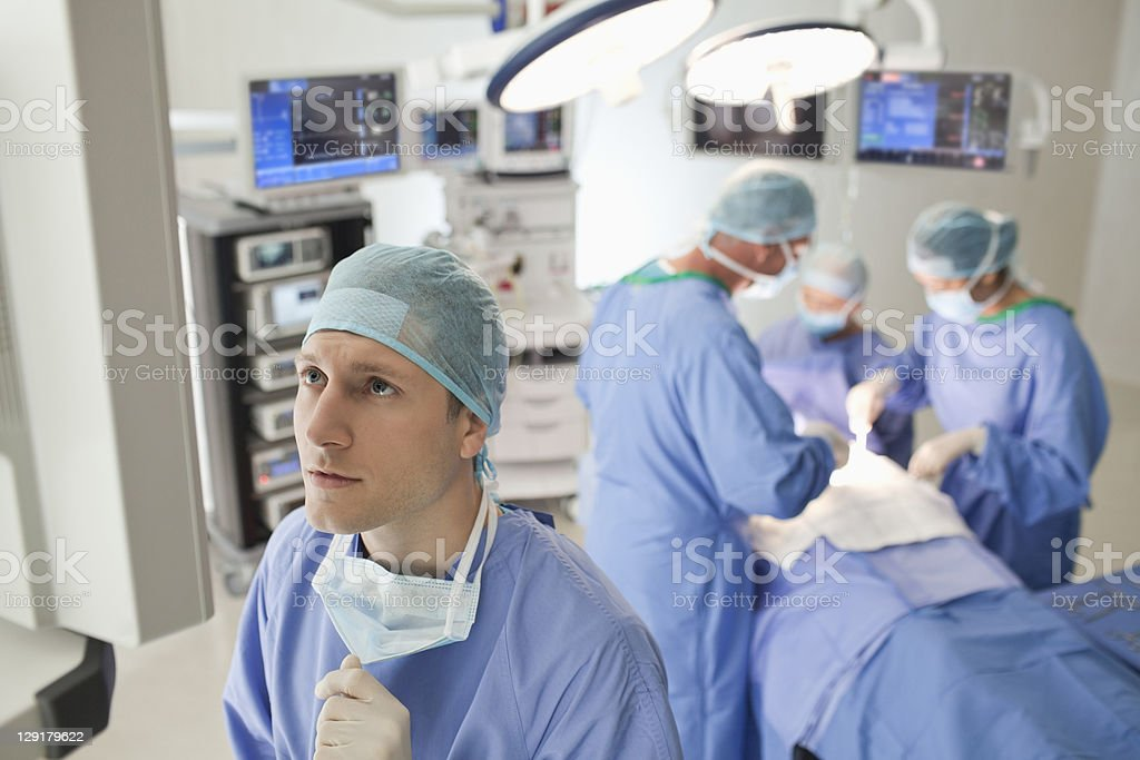 Young male doctor looking away royalty-free stock photo