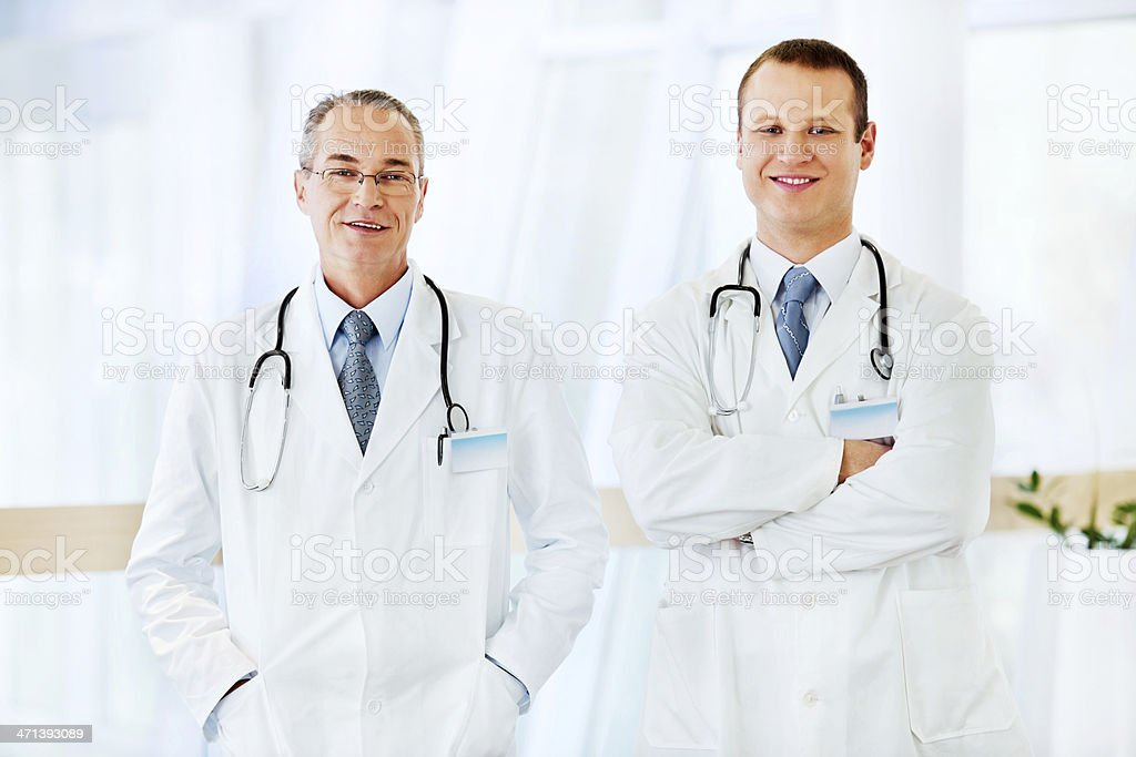 Young male doctor with  senior colleague. royalty-free stock photo