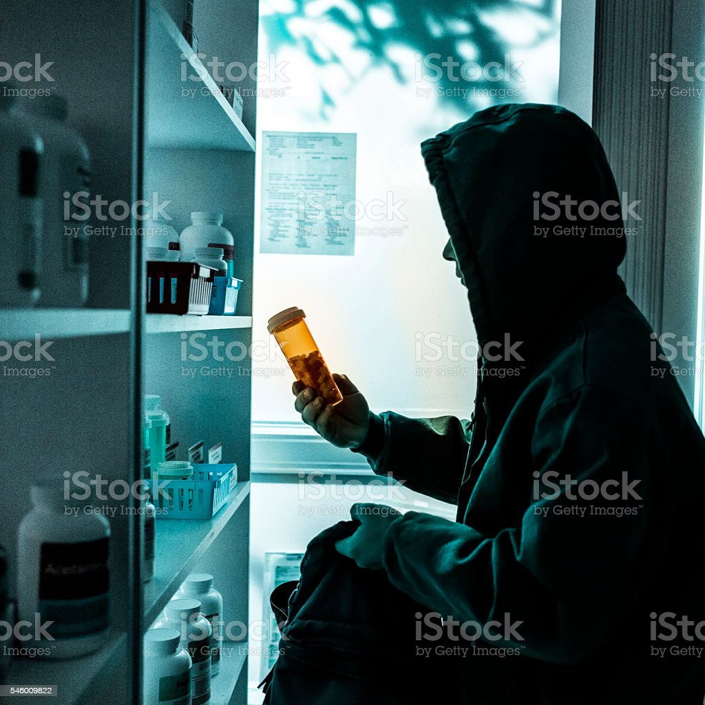 A young male drug addict stealing prescriptions. stock photo