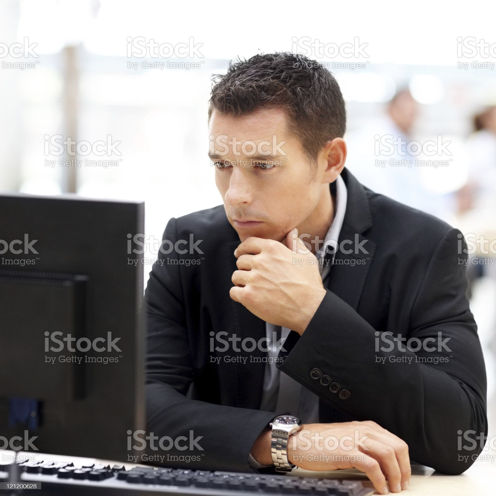 Young male entrepreneur using computer in the office royalty-free stock photo