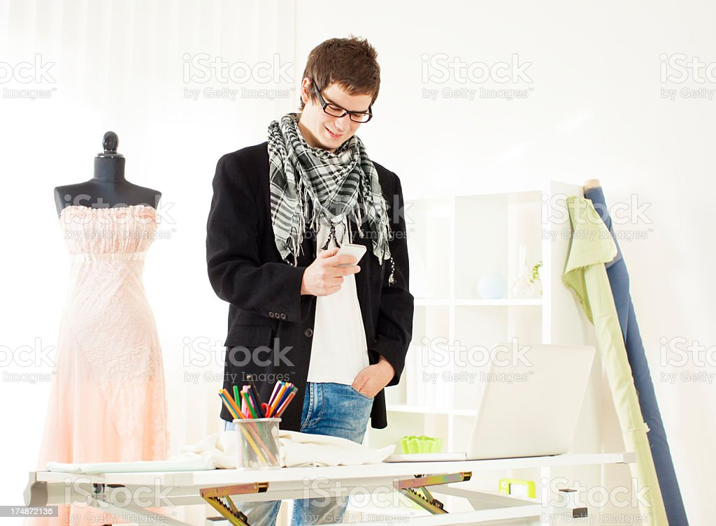 Young Male Fashion Designer Texting. royalty-free stock photo