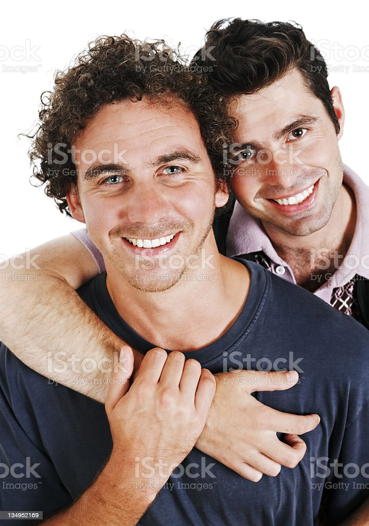 Young male gay couple clasp hands affectionately royalty-free stock photo