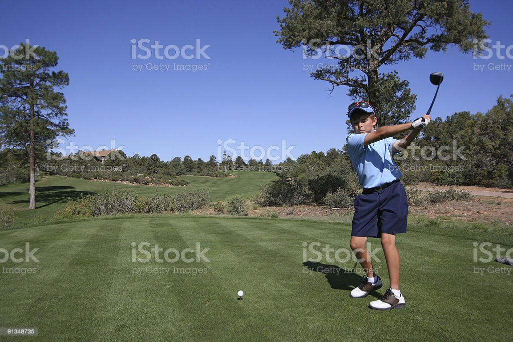 Young male golfer about to tee off on golf course royalty-free stock photo