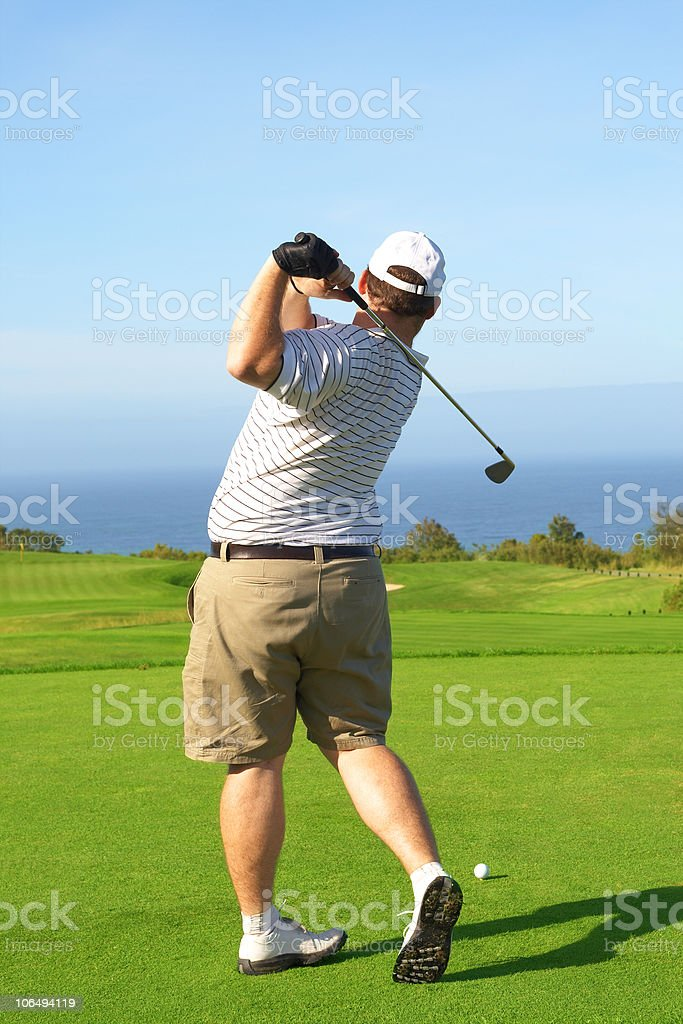 Young male golfer royalty-free stock photo