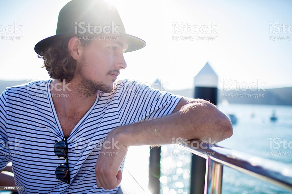 Young male hipster on ferry deck Sydney Harbour stock photo